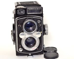 Old film cameras, 35mm or 120 size. Also, B&W film.