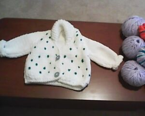 Hand-knitted baby sweaters