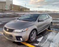2011 Kia Forte Coupe. Low KMs! Snow-rated tires. Excellent shape