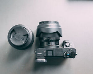SIGMA 30MM F1.4 DC C DN SONY E LENS $429with a UV filter and a v