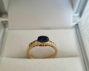 Womens 14k gold ring with sapphire in middle and 6 diamonds
