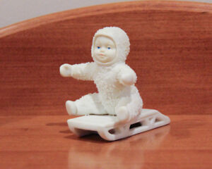 "Snowbabies collectable figure ""Give me a push"""