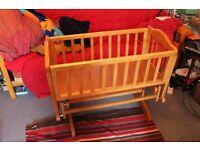 Wooden Rocking/Gliding Crib Good used condition £30 Heavitree