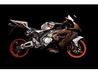 Motorcycle spray painting and air brushing