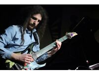 Electric guitarist / theremin player / composer available for collaborations and lessons