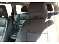 Volvo leather seats driver passenger and back seats