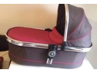 Pink and gray Icandy carrycot