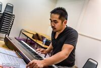 Piano/vocal/theory lessons.  Music director/conductor