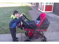 REDUCED NEED GONE ASAP Bebecar IP OP evolution in black with red leather pram system