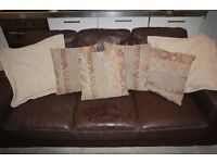 2 large brown faux leather sofas 3 + 2 + cushions