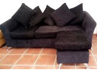 Brand new condition black sofa with foot stool.