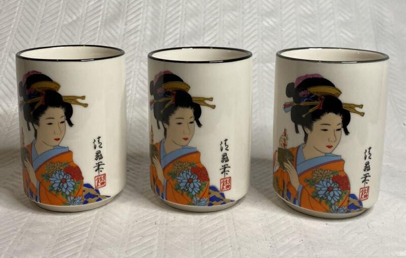 Three Asian tea cups with geisha girl.