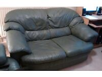 2 seater dark green leather sofa and 2 one-seater leather armchairs