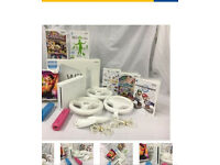 Nintendo wii console package fully boxed with games controllers wii fit board
