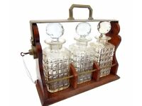 An early 20th century oak cased Tantalus x 3 decantors circa 1933