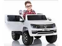 Licensed VW AMAROK ride on car with remote control music and lights (leeds) only £270