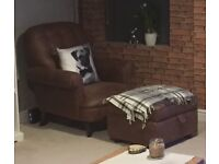 Brown faux leather arm chair and footstool