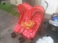 Red zeta double pram with raincovers