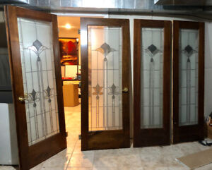 Interior wooden doors/stain glass with matching side panels.