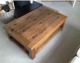 Solid wood coffee table with built in shelf underneath