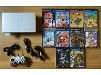PlayStation 2 console and kids games. PS2