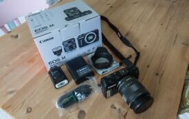 Canon EOS M 18 MP with EF-M 18-55mm f/3.5-5.6 IS STM standard zoom and Lowepro case