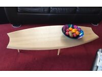 Shield shaped ash wood coffee table. Good condition. Unusual, light, useful size.