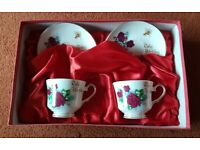 Pair of Bone China Ruby Wedding Cups and Saucers