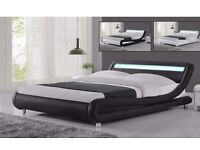 Kingsize black faux leather bed with led headboard