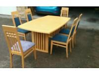 Dinning Table, seats 6 extends to 8, and 6 chairs.