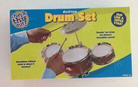 Desktop mini drum set. Toy drum set for desk. Musical instrument