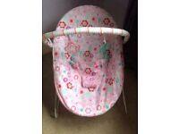Pink vibrating baby bouncer