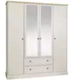 A new still boxed ivory and oak effect 4 door 2 drawer wardrobe .