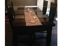 Black gloss extendable dinning table and 4 chairs
