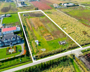 PRICE REDUCED! $1,775,000 4.97 Acres • Land Only Farm
