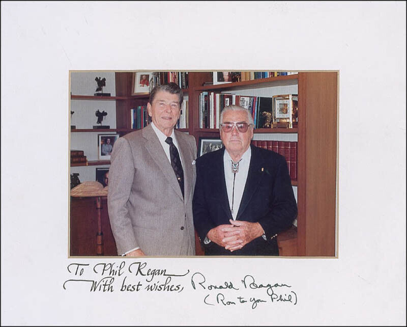 RONALD REAGAN - INSCRIBED PHOTOGRAPH MOUNT SIGNED