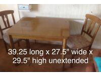 Lawson Imports Solid wood table with 2 padded chairs