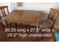 Lawton Imports solid wood extending table and 2 padded chairs