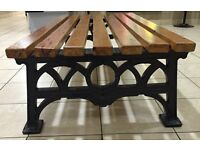Garden bench with heavy cast iron legs and solid wood slats