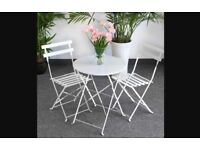 White garden table and two chairs