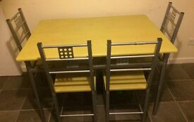 Dining table and chairs collect leven