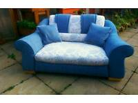 Duck egg blue and flower pattern sofa.