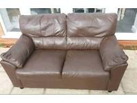 Two seat brown leather sofa in very good condition - can deliver