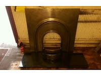 Vintage style iron fire place surround with black granite hearth.