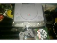 PlayStation ps1 console with tomb raider