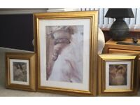 Three gilt colored frame with prints