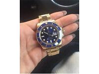 Rolex submariner 18k gold / blue 2014