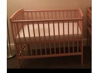 Lovely pink cot and mattress in excellent condition.