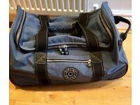 "Kipling ""blue jean"" wheeled duffel bag"