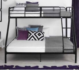 Black metal single over double bunk bed